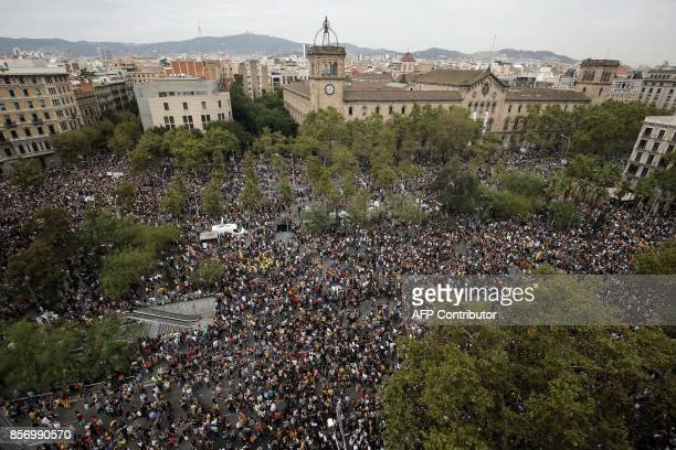 Protesters gather at the Placa de la Universitat square in Barcelona during a general strike in Catalonia called by Catalan unions on October 3,...