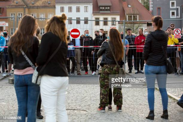 Protesters gather behind the fence on the German side of The ZgorzelecGorlitz Old Town Bridge during the demonstration Hundreds of polishGermany...