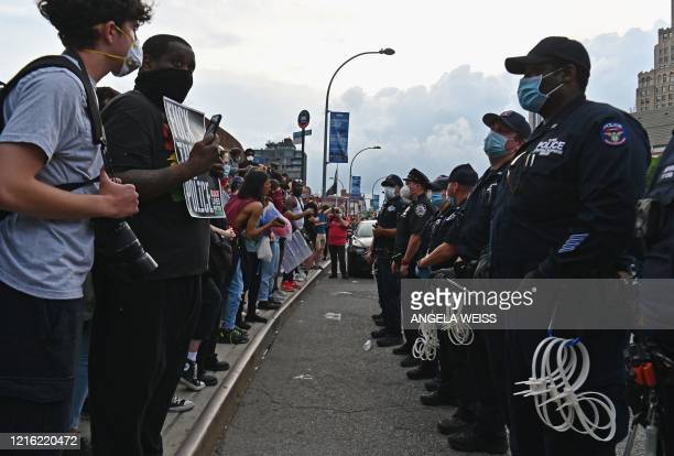 Protesters gather during a Black Lives Matter protest near Barclays Center on May 29 2020 in the Brooklyn borough of New York City in outrage after...