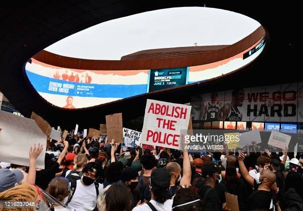 TOPSHOT Protesters gather during a Black Lives Matter protest near Barclays Center on May 29 2020 in the Brooklyn borough of New York City in outrage...