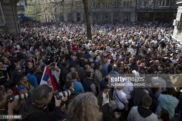 Protesters gather during a demonstration against Serbian President Aleksandar Vucic outside the presidential building in Belgrade on March 17 2019...