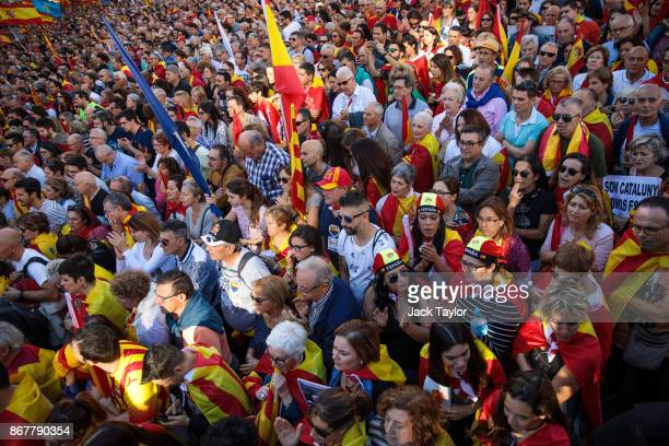 Protesters gather during a prounity demonstration on October 29 2017 in Barcelona Spain Thousands of prounity protesters gather in Barcelona two days...