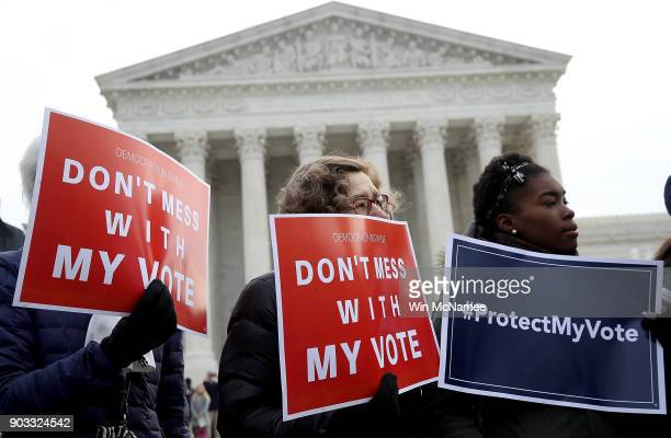 Protesters gather during a rally held by the group Common Cause in front of the US Supreme Court January 10 2018 in Washington DC Voting rights...