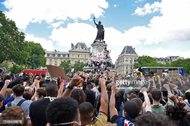 Protesters gather during a rally in solidarity with the worldwide 'Black Lives Matter' protests against racism and police brutality on Place de la...