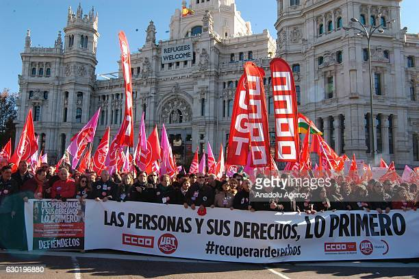 Protesters gather during an antigovernment demonstration organized by the General Workers' Union of Spain and Spain's Workers' Commissions in support...