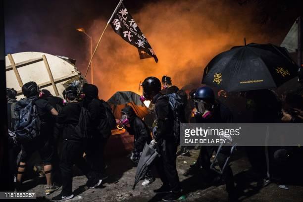 Protesters gather during clashes with police at the Chinese University of Hong Kong , in Hong Kong on November 12, 2019. - Hong Kong pro-democracy...