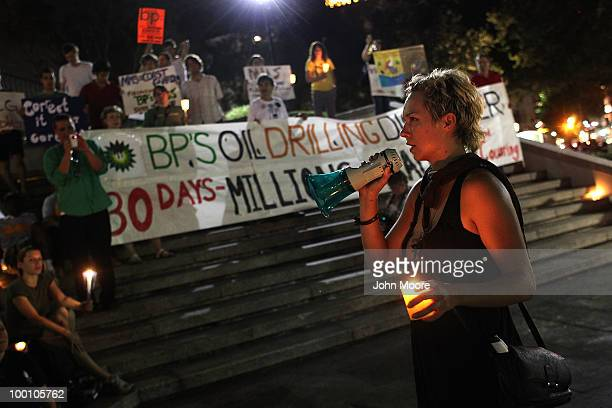 Protesters gather for a candlelight vigil to mark the month anniversary of the BP oil spill on May 20 2010 in New Orleans Louisiana BP says that it...