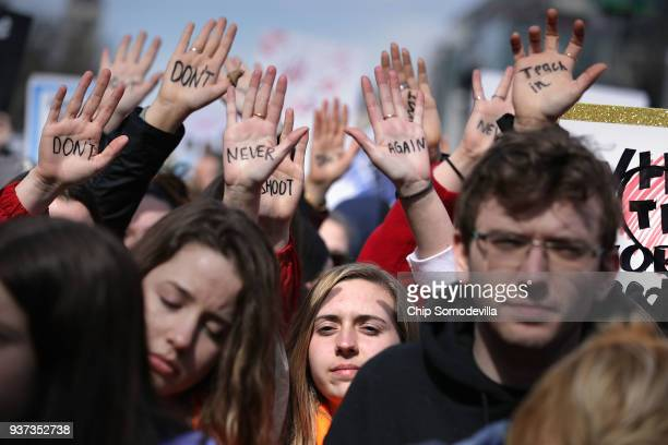Protesters gather for the March for Our Lives rally along Pennsylvania Avenue March 24 2018 in Washington DC Hundreds of thousands of demonstrators...