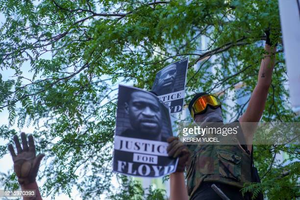 TOPSHOT Protesters gather in a call for justice for George Floyd a black man who died after a white policeman kneeled on his neck for several minutes...