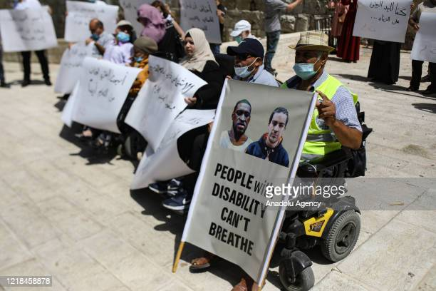 Protesters gather in front of Es-Sahire gate in the Old City of East Jerusalem for autistic Palestinian man Iyad Hallak , who were killed by Israeli...