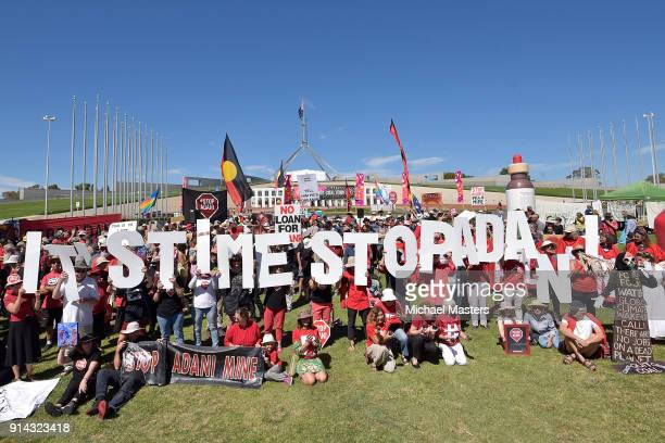Protesters gather in front of Parliament House to campaign against the construction of the Adani coal mine on February 5 2018 in Canberra Australia...
