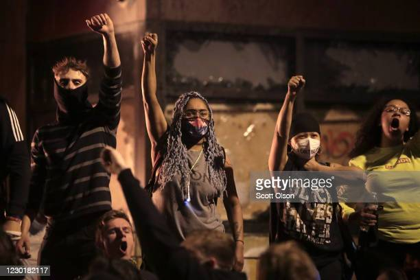 Protesters gather in front of the 3rd precinct police building while it burns on May 28 2020 in Minneapolis Minnesota Today marks the third day of...