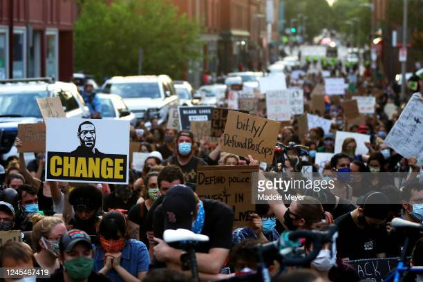 Protesters gather in front of the Boston Police District E13 Jamaica Plain office during a protest on June 04 2020 in Boston Massachusetts The...