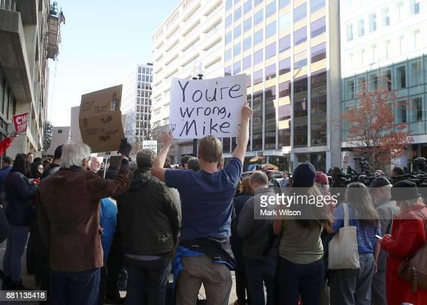 Protesters gather in front of the Consumer Financial Protection Bureau headquarters on November 28 2017 in Washington DC Sen Elizabeth Warren spoke...