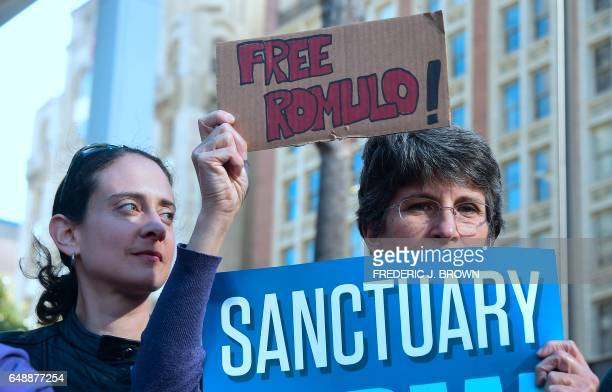 Protesters gather in front of the Los Angeles Immigration Court building in downtown Los Angeles California on March 6 2017 after a rally by...