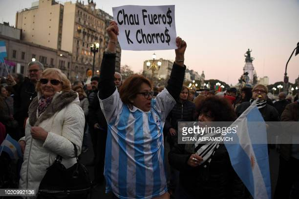 Protesters gather in front of the National Congress in Buenos Aires on August 21 2018 to demand senators to strip former Argentine president Cristina...