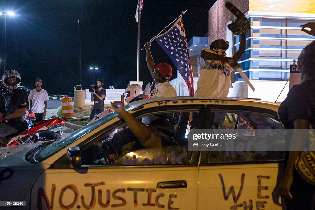 Protests Continue Over Police Shooting Of Michael Brown : News Photo