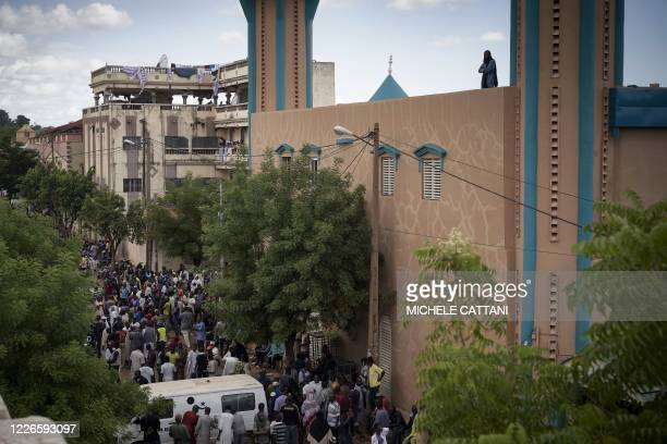 Protesters gather in front of the Salam mosque of Badalabougou where the influent Imam Mahmoud Dicko led a prayer dedicated to the victims of the...