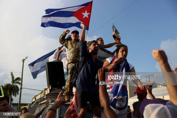 Protesters gather in front of the Versailles restaurant to show support for the people in Cuba who have taken to the streets there to protest on July...