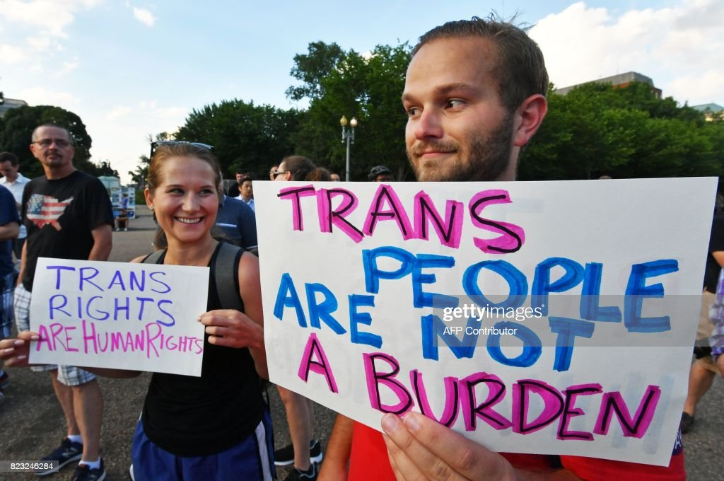 Protesters gather in front of the White House on July 26, 2017, in Washington, DC. Trump announced on July 26 that transgender people may not serve 'in any capacity' in the US military, citing the 'tremendous medical costs and disruption' their presence would cause. /