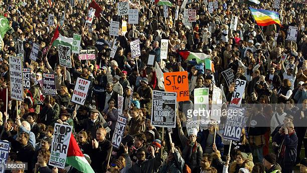 Protesters gather in Hyde Park to listen to speeches after an antiwar demonstration March 20 2003 in London England Approximately 3500 police...
