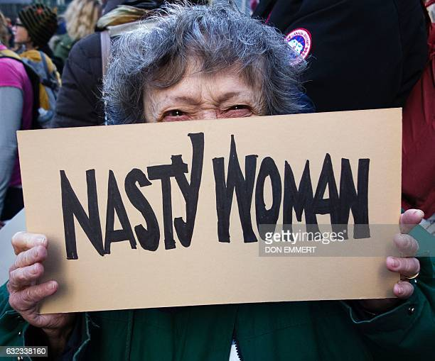 Protesters gather in midtown Manhattan as part of the Women's march vowing to resist US President Trump January 21 2017 in New York Hundreds of...