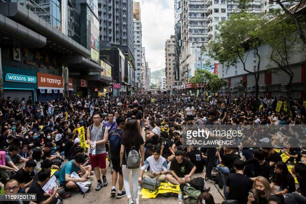 TOPSHOT Protesters gather in Mongkok during a general strike in Hong Kong on August 5 as simultaneous rallies were held across seven districts Hong...