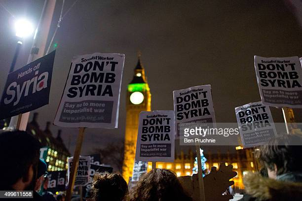 Protesters gather in Parliament Square ahead of a 'Die In' protest on December 2 2015 in London England ritish MPs are expected to vote tonight on...