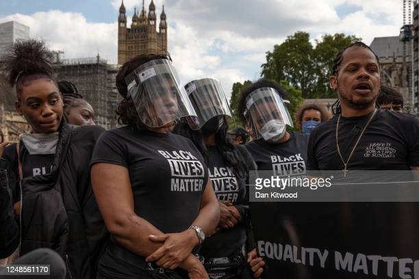 Protesters gather in Parliament Square to commemorate the life of George Floyd at 5pm, the time when his body will be laid to rest in Houston, Texas,...