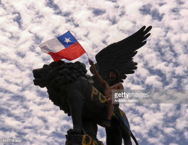 Protesters gather in Santiago to inflict improvements in the constitution and resignation of President Sebastian Pinera on the fifth day of social...