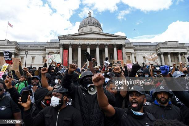 TOPSHOT Protesters gather in support of the Black Lives Matter movement for a protest action in Trafalgar Sqaure in central London on June 13 in the...
