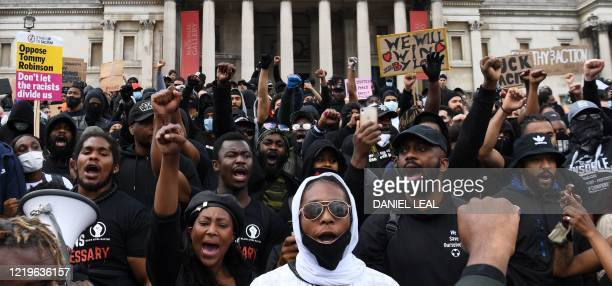 Protesters gather in support of the Black Lives Matter movement for a protest action in Trafalgar Sqaure in central London on June 13 in the...