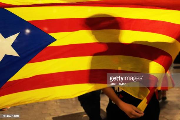Protesters gather in the city centre to demonstrate against the Spanish federal government's move to suspend Catalonian autonomy on October 21 2017...