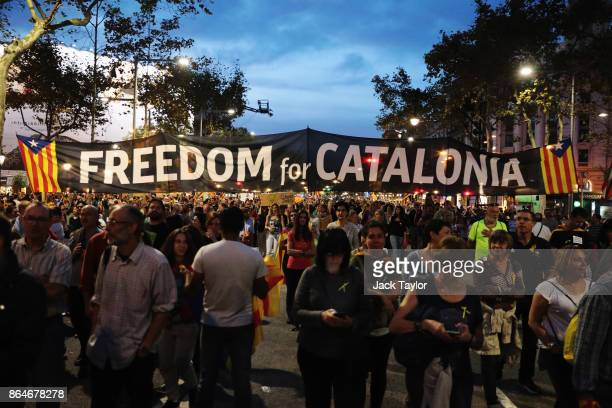 Protesters gather in the city centre to demonstrate against the Spanish federal government's move to suspend Catalonian autonomy on October 21, 2017...
