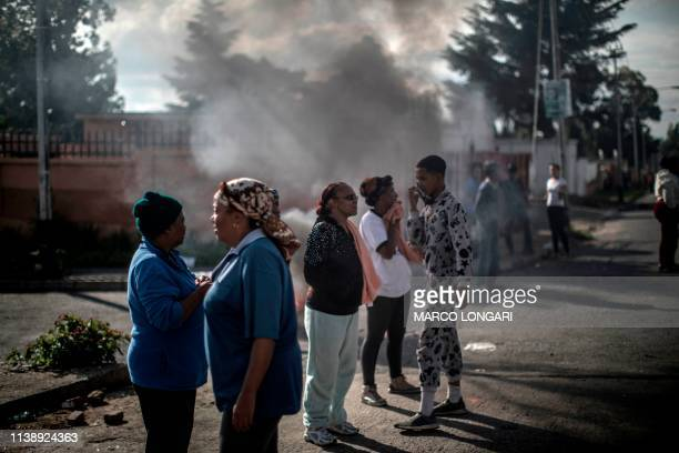 Protesters gather in the streets of Johannesburg on April 23 2019 during a protest against the lack of service delivery or basic necessities such as...