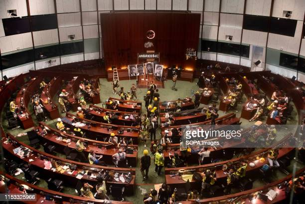 Protesters gather inside the chamber meeting hall of the Legislative Council during the demonstration Hundreds of antigovernment protesters stormed...