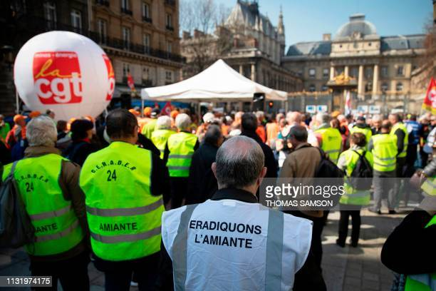 Protesters gather near the courthouse in Paris, on March 22 while the Court of Cassation examines an anxiety damage compensation for some workers...