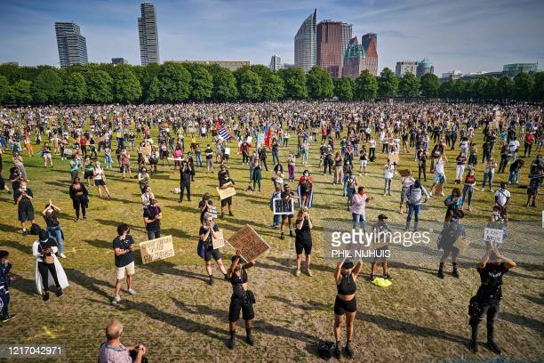 TOPSHOT Protesters gather observing social distancing during a demonstration on the Malieveld in The Hague on June 2 after the police killing of...