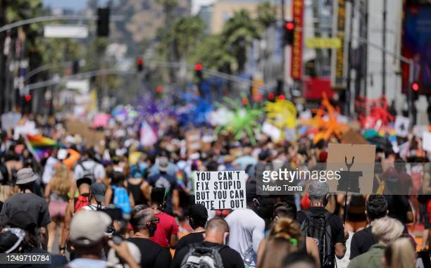 Protesters gather on Hollywood Boulevard during the All Black Lives Matter solidarity march replacing the annual gay pride celebration as protests...
