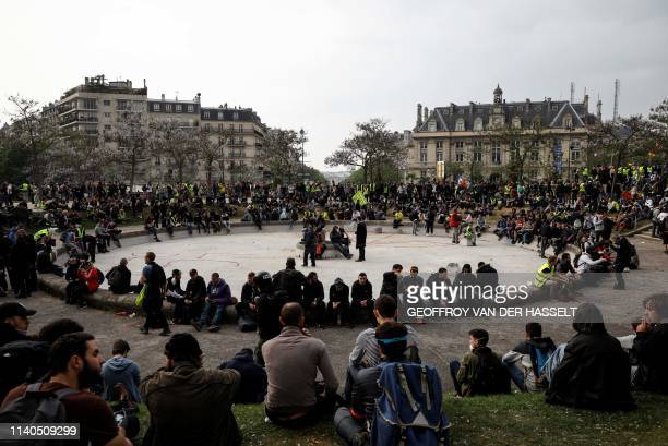 Protesters gather on the Place d'Italie at the end of the annual May Day rally in Paris on May 1 2019 Paris riot police fired teargas as they squared...