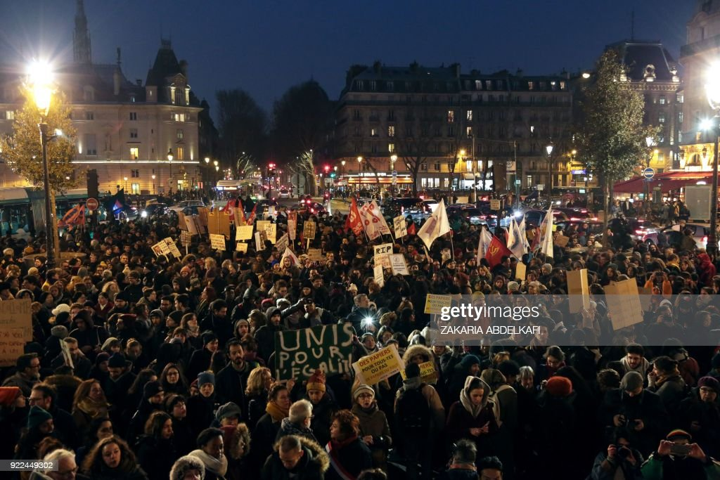 Protesters gather on the Place Saint-Michel in Paris on February 21, 2018, during a demonstration against the French government's new immigration bill. The French government defended a new immigrat...