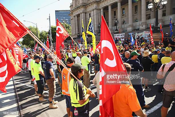Protesters gather on the steps of State Parliament during a union organised protest against temporary worker visas on March 7 2013 in Melbourne...