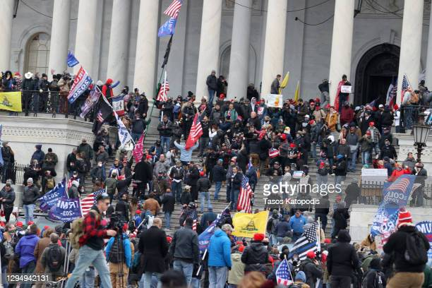 Protesters gather on the U.S. Capitol Building on January 06, 2021 in Washington, DC. Pro-Trump protesters entered the U.S. Capitol building after...
