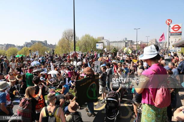 Protesters gather on Waterloo Bridge as the Extinction Rebellion protests enter their seventh day on April 21 2019 in London England The...