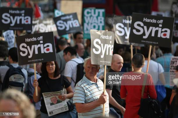 Protesters gather on Whitehall outside Downing Street to campaign for no international military intervention in the ongoing conflict in Syria on...