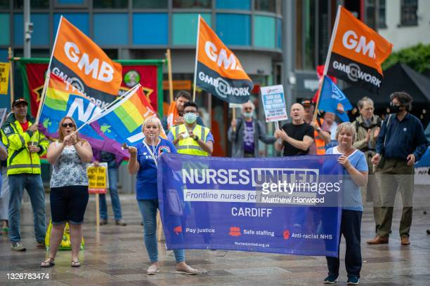 Protesters gather outside Cardiff Central Library during a protest on July 3, 2021 in Cardiff, United Kingdom. On July 05, 1948 the National Health...