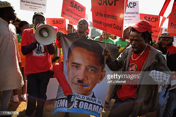 Protesters gather outside Johannesburg University in Soweto in advance of President Obama'smeeting with students later today on June 29 2013 in...