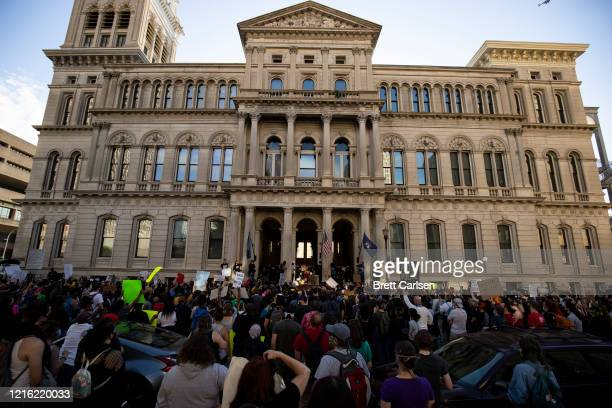 Protesters gather outside of City Hall after a peaceful march across the city on May 29 2020 in Louisville Kentucky Protests have erupted after...