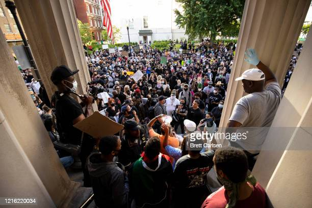 Protesters gather outside of City Hall after a peaceful march across the city on May 29, 2020 in Louisville, Kentucky. Protests have erupted after...