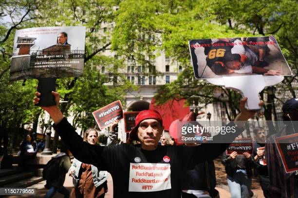 Protesters gather outside of Police Headquarters in Manhattan to protest during the police disciplinary hearing for Officer Daniel Pantaleo who was...